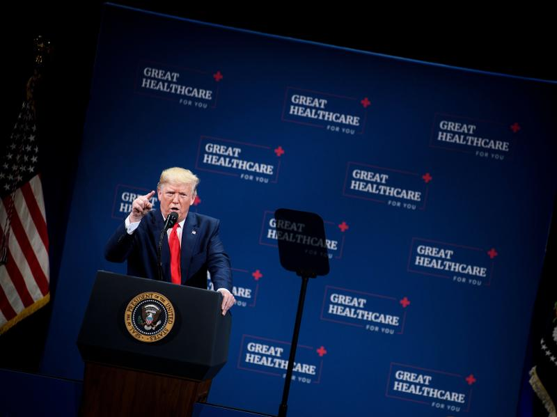 """President Trump talked to seniors about health care in central Florida in early October. """"We eliminated Obamacare's horrible, horrible, very expensive and very unfair, unpopular individual mandate,"""" Trump told the crowd."""