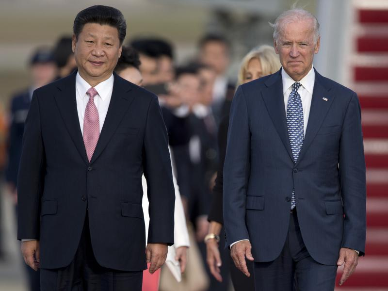 Chinese President Xi Jinping and then Vice President Joe Biden attend an arrival ceremony in Andrews Air Force Base, Md., in 2015. Biden is under pressure from both the left and the right to continue taking a hard line on trade with China.