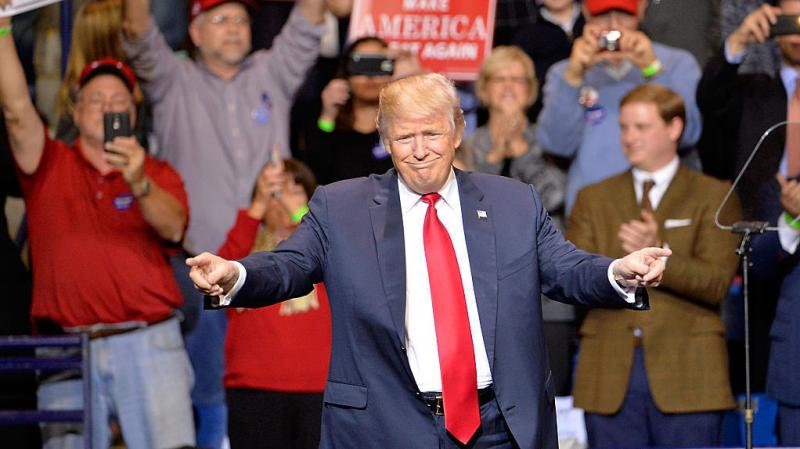 "President-elect Donald Trump points to his supporters during his ""Thank You"" rally in Fayetteville, N.C., on Tuesday night."