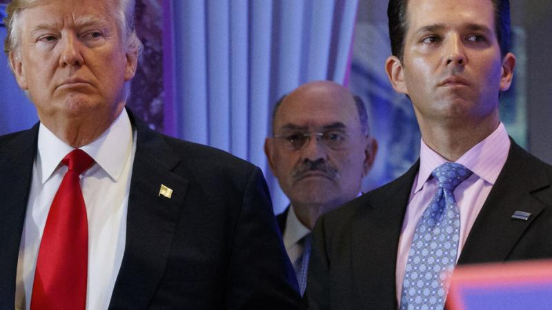 Allen Weisselberg (center), the longtime chief financial officer of former President Donald Trump's family business, stands behind Trump during a 2017 news conference at Trump Tower in New York City. Weisselberg, who appeared in court Monday, has pleaded