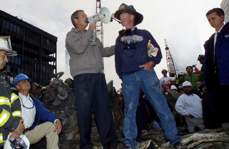 President George W. Bush stands in the rubble of the World Trade Center in New York and speaks to workers involved in the cleanup effort on Sept. 14, 2001.