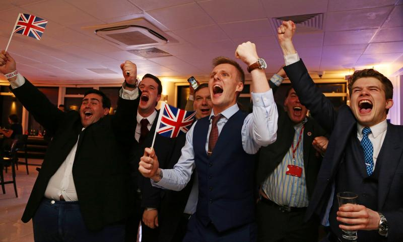 Advocates for the U.K. leaving the EU wave Union flags and cheer as the results come in at the Leave.EU referendum party at Millbank Tower in central London early Friday morning.