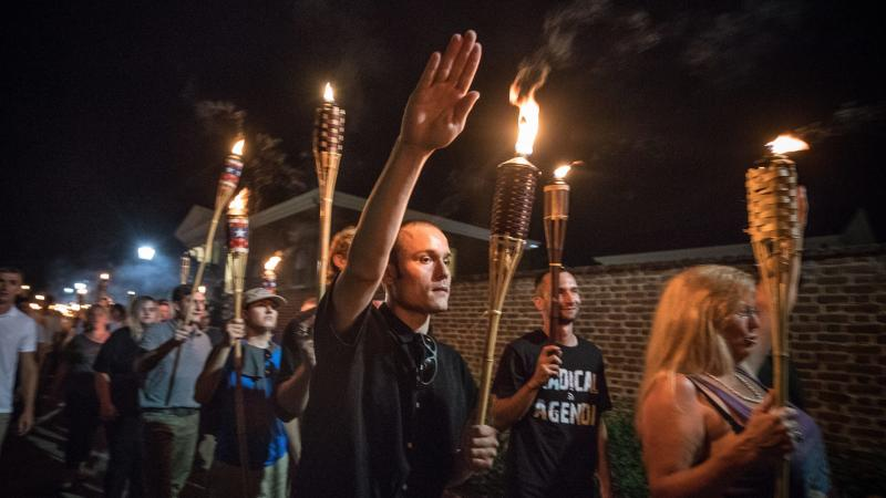 """Chants of """"White lives matter!"""" """"You will not replace us!"""" and """"Jews will not replace us!"""" rang out on Aug. 11 as several hundred white nationalists and supremacists carried torches through the University of Virginia."""