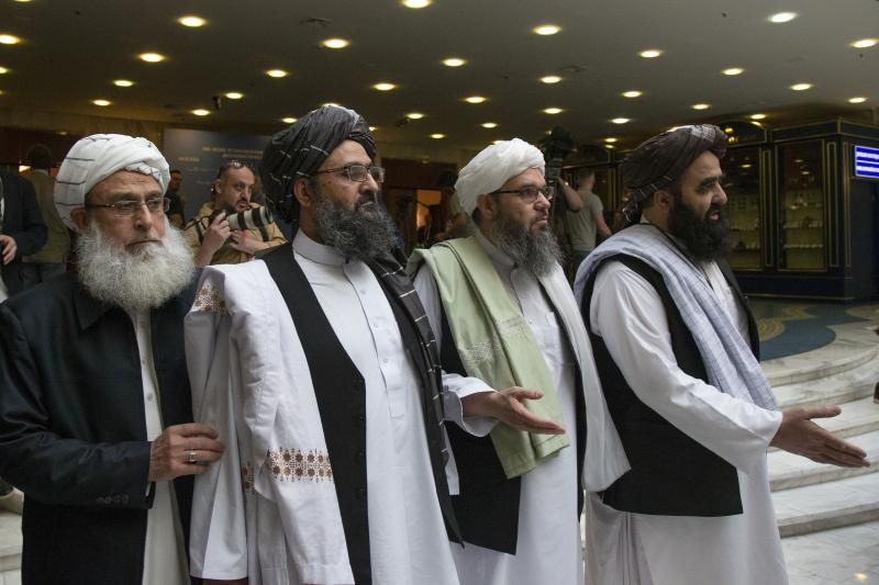 Mullah Abdul Ghani Baradar, the Taliban's top political leader (second from left), has been involved in the group's negotiations with U.S. officials.
