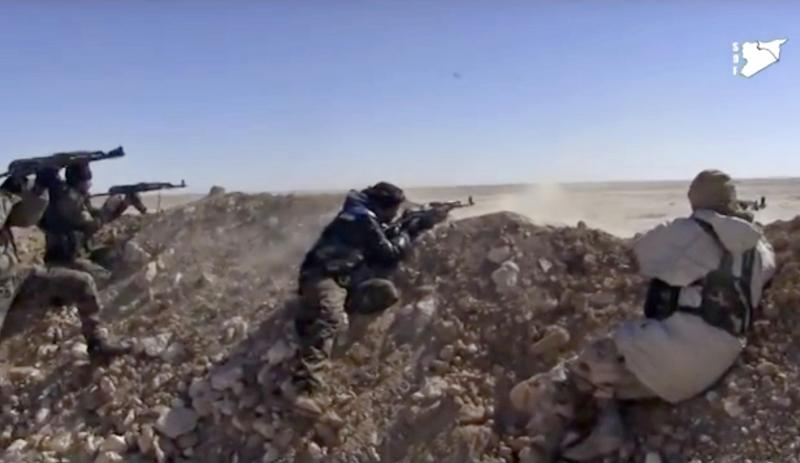 Syrian Democratic Forces fighters opening fire on an Islamic State group's position in March in the countryside east of Raqqa, Syria.