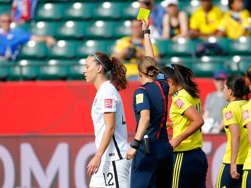Lauren Holiday of the United States is given a yellow card Monday in the first half against Colombia in a Women's World Cup match in Edmonton, Canada. She also received one in an earlier match against Australia, so Holiday will be suspended for the Americ