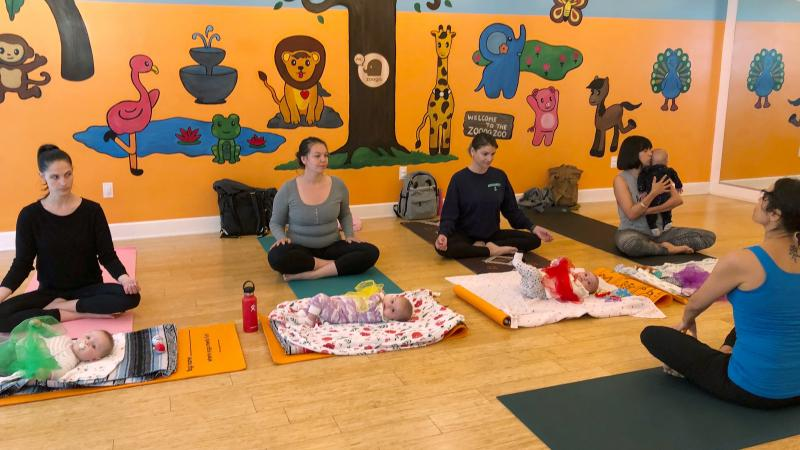 In 2018, U.S. birthrates fell for nearly all racial and age groups, the CDC says. Here, mothers and babies attend a yoga class in Culver City, Calif., in March.