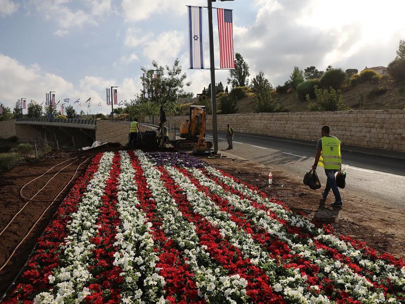 An American flag is designed in flowers near the entrance to the new American Embassy in Jerusalem, which is scheduled to open on Monday. It is a controversial move.