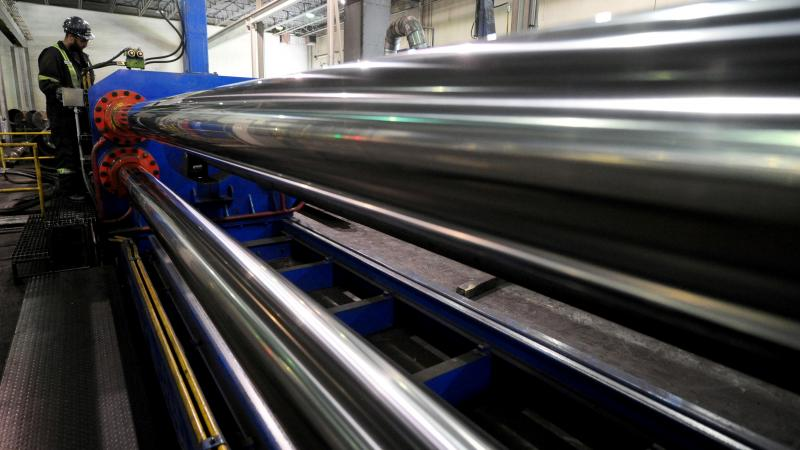 The U.S. is lifting tariffs on Canadian and Mexican steel imports, nearly a year after imposing the duties. Here, a worker is seen at Bri-Steel Manufacturing, which makes seamless steel pipes, in Edmonton, Alberta, Canada.