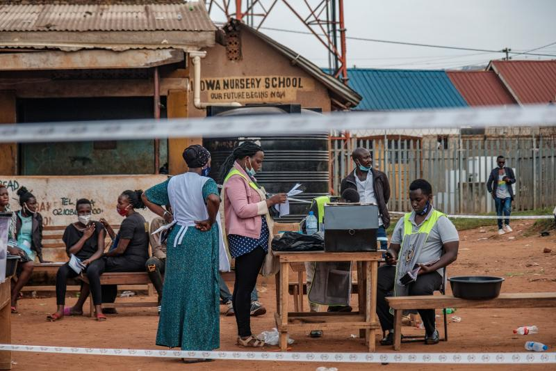 Ugandan election commission officials count ballots after the polls closed at a polling station in Kampala on Thursday.
