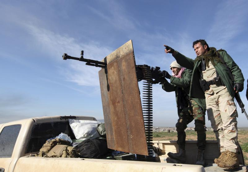 Kurdish peshmerga fighters keep watch during the battle with Islamic State militants on the outskirts of Mosul on Jan. 21.
