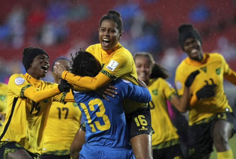 Jamaica's Reggae Girlz celebrate winning a penalty kick shootout against Panama to advance to this year's Women's World Cup.