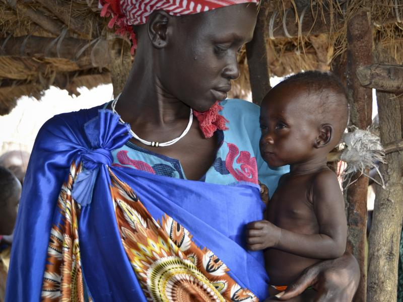 Elizabeth Nyakoda holds her 10-month-old daughter at a feeding center for children in South Sudan.