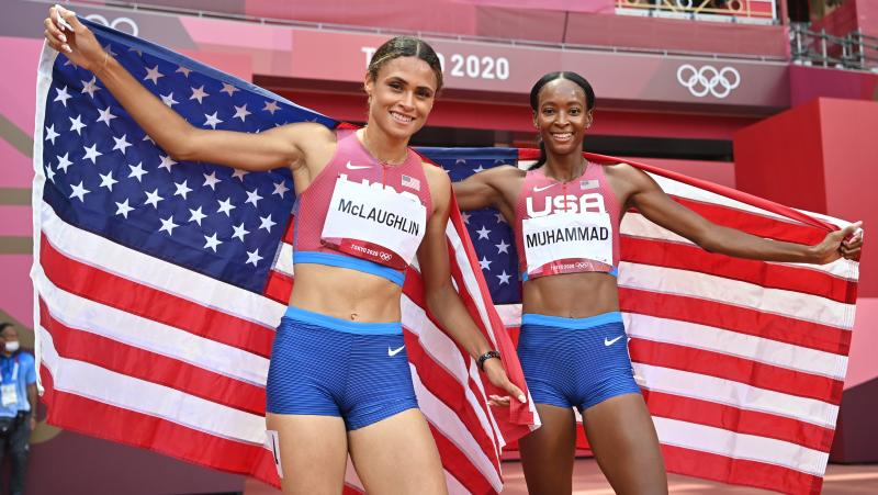 Team USA topped the medals list at the Tokyo Games, narrowly edging China in golds. Here, track stars Sydney McLaughlin (left) and Dalilah Muhammad celebrate winning gold and silver respectively in the women's 400-meter hurdles in Tokyo.