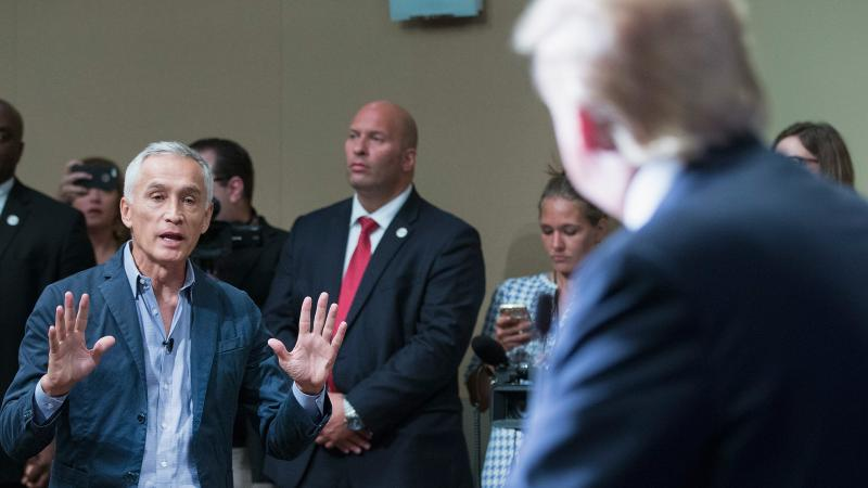 Univision anchor Jorge Ramos asks a question of presidential candidate Donald Trump during a news conference in Dubuque, Iowa, on Aug. 25. Earlier, Trump had Ramos removed from the room.