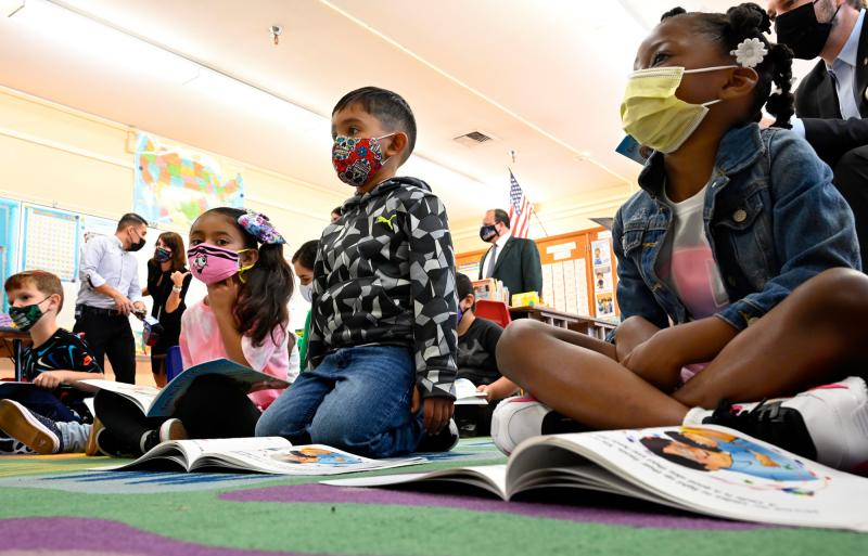 First-graders listen to the interim superintendent of the Los Angeles Unified School District, Megan Reilly, read a book at Normont Elementary School in Harbor City on Aug. 16, the first day of school.