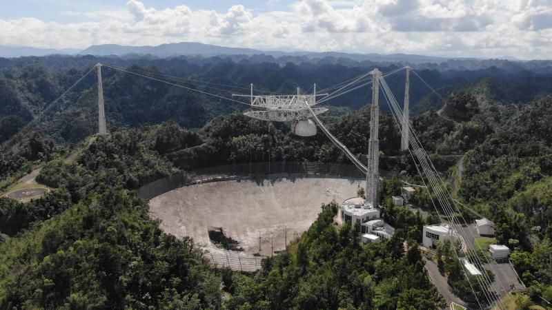 The Arecibo Observatory's mammoth telescope collapsed overnight. It's seen here in November, after a cable damaged its dish.