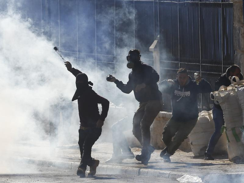 Palestinians in the West Bank clash with Israeli troops during a protest against President Trump's recognition of Jerusalem as Israel's capital.