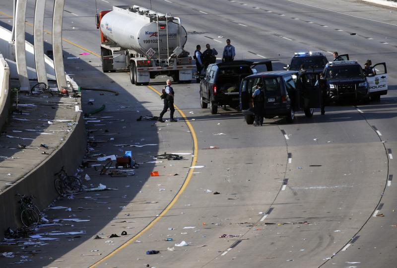 Police clear the area where a tanker truck rushed to a stop among protesters on an interstate highway on Sunday in Minneapolis.