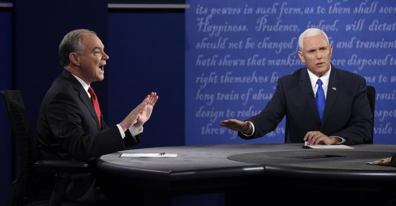 Sen. Tim Kaine, D-Va., left, and Gov. Mike Pence, R-Ind., speak during the vice presidential debate at Longwood University in Farmville, Va.