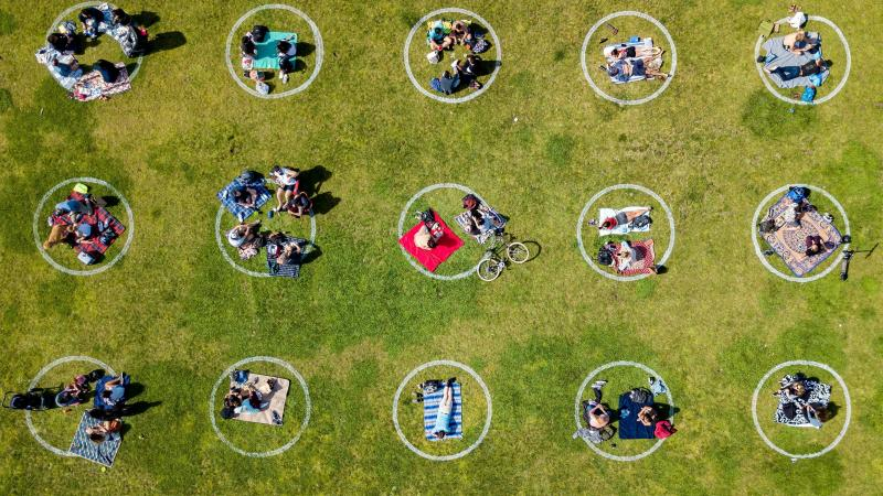An aerial view shows people gathered in painted circles on the grass encouraging social distancing last week at Dolores Park in San Francisco.