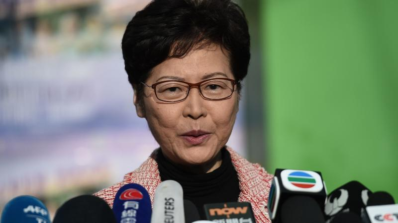 """Hong Kong Chief Executive Carrie Lam addresses the media after casting her vote during Sunday's district council elections. After results showed a landslide victory for pro-democracy candidates, Lam said she would listen """"humbly"""" to the will of the voters"""