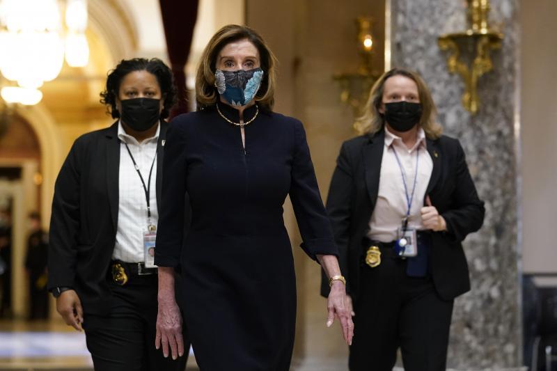 Speaker of the House Nancy Pelosi of Calif., walks through Statuary Hall on Capitol Hill on Wednesday.