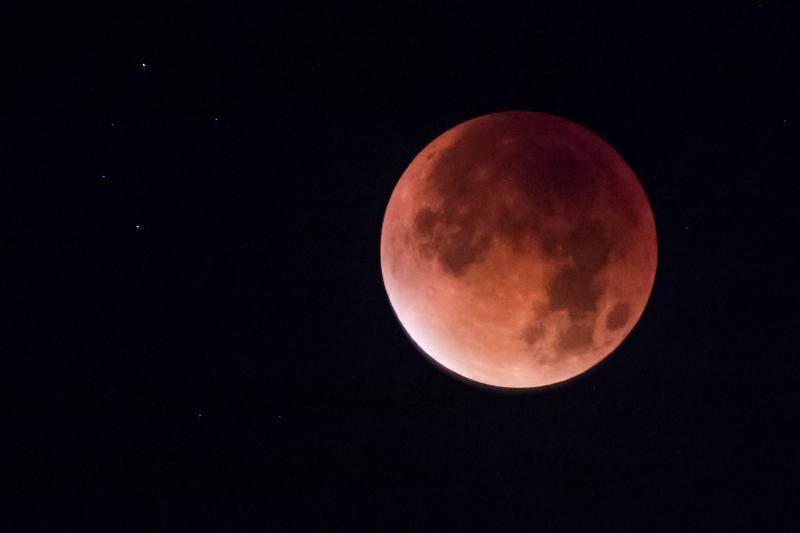 Earth's shadow obscures the view of a so-called supermoon during another total lunar eclipse — this one in Brussels in 2015.