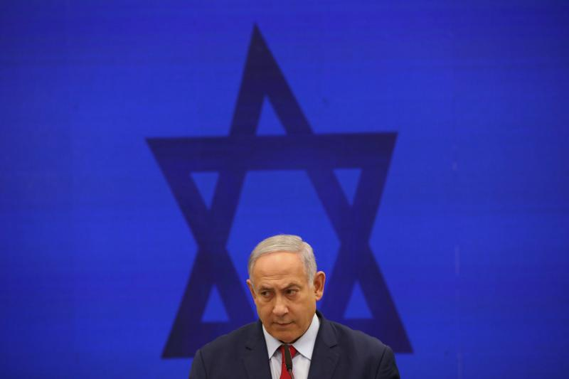 Israeli Prime Minister Benjamin Netanyahu speaks during a news conference in Tel Aviv last September. Netanyahu, the country's longest-serving prime minister, will go to court on Sunday charged with bribery, fraud and breach of trust.