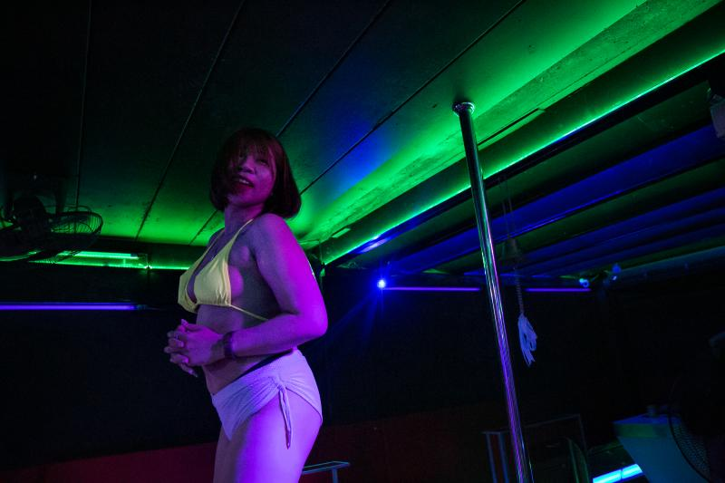 M. dances at a go-go bar. She was working as a topless dancer — and also as a sex worker — in the tourist city of Pattaya, Thailand, until the bar closed down in January. She decided to return to her hometown to look for work in a different sector.