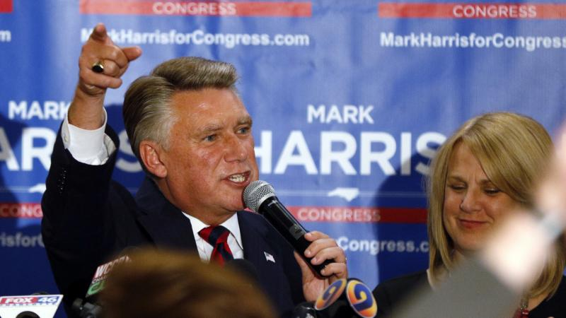 North Carolina 9th district Republican congressional candidate Mark Harris, with his wife Beth, claims victory in his congressional race in Monroe, N.C. The race, however, has yet to be certified as authorities look into fraud claims in the eastern part o