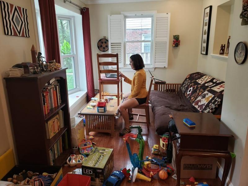 Gretchen Goldman shared this behind-the-scenes photo on Twitter of what it's like to work from home and parent during the pandemic.