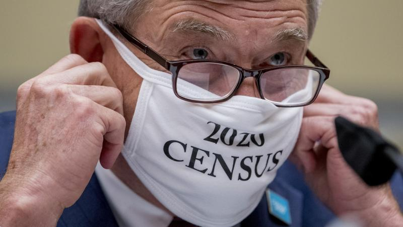 """Census Bureau Director Steven Dillingham, wearing a face covering printed with the words """"2020 Census,"""" testified before the House oversight committee Wednesday that the bureau plans to finish counting """"as soon as possible"""" despite career officials previo"""