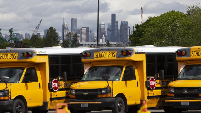 School buses sit idle in a Seattle bus yard. On July 2, Seattle Public Schools announced it is planning to resume some in-person learning in the new school year.