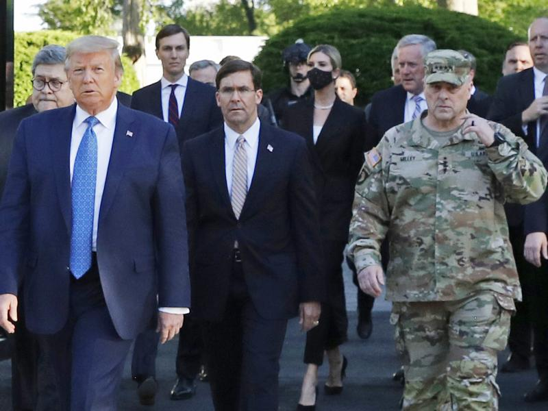 """President Trump walking from the White House to St. John's Church on June 1. Gen. Mark Milley (far right), chairman of the Joint Chiefs of Staff, was among those walking behind the president. Milley says his presence was """"a mistake"""" that he has learned fr"""