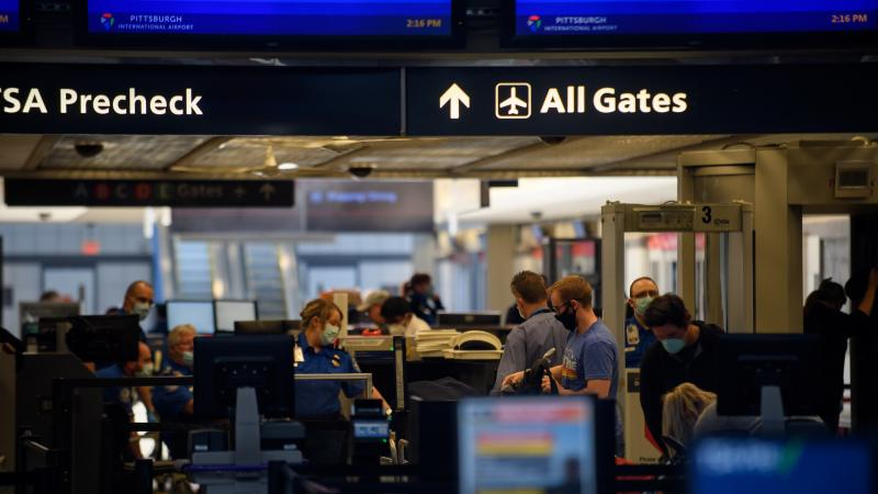Travelers make their way through ticketing and TSA inspection at the Pittsburgh International Airport on May 7.