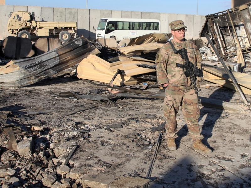 A U.S. soldier stands at a spot struck by Iranian missiles in January at Ain al-Asad air base in Iraq's Anbar province. The attack was in retaliation for the U.S. drone strike that killed Iranian Gen. Qassem Soleimani. The U.S. is drawing down 2,500 troop