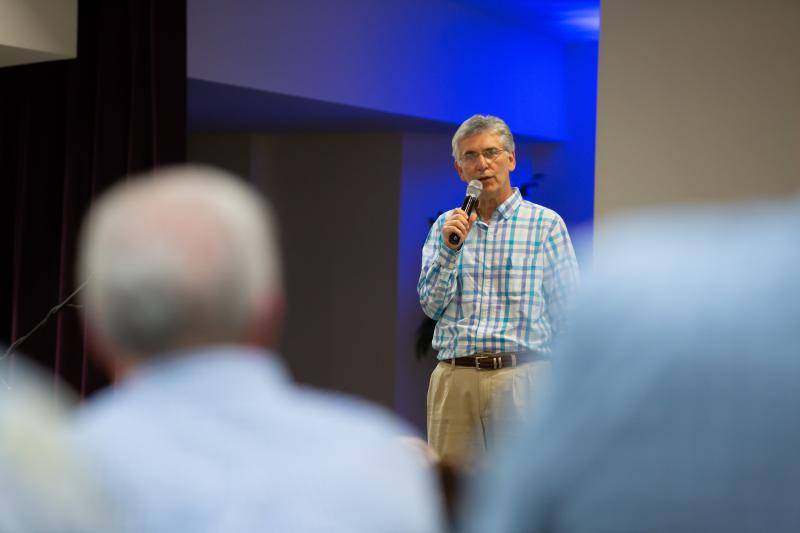 """Pastor Jay Wolf leads a prayer service at First Baptist Church in Montgomery in 2019. He says he has """"no idea"""" how many African Americans are in his congregation. """"We are the body of Christ, and we need Jesus, and that's all I need to know,"""" he says."""