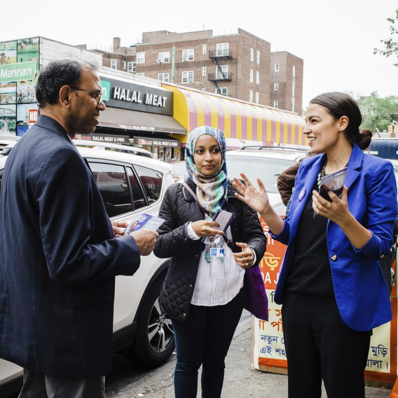 A May 2016 photo provided by the Alexandria Ocasio-Cortez campaign shows the candidate during a Bengali community outreach event in New York.