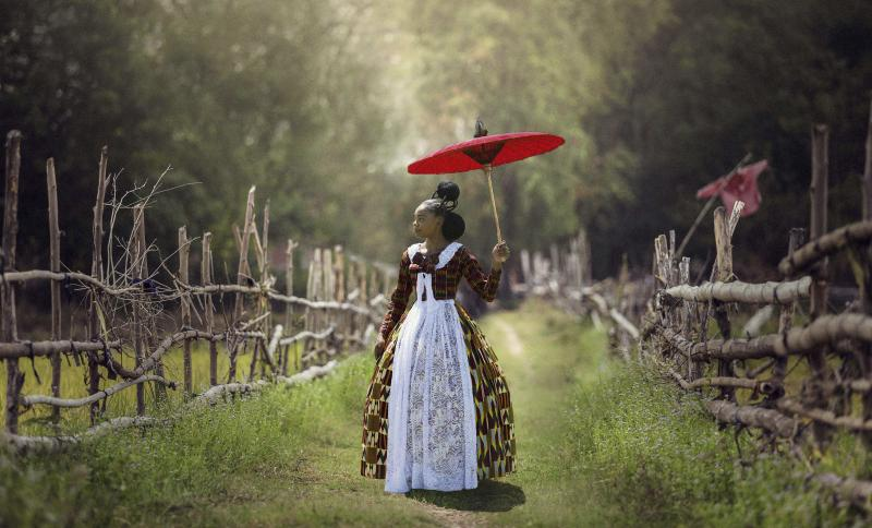 In Voyages of an African Victorian, a woman wears a Victorian-style dress made of African fabrics.
