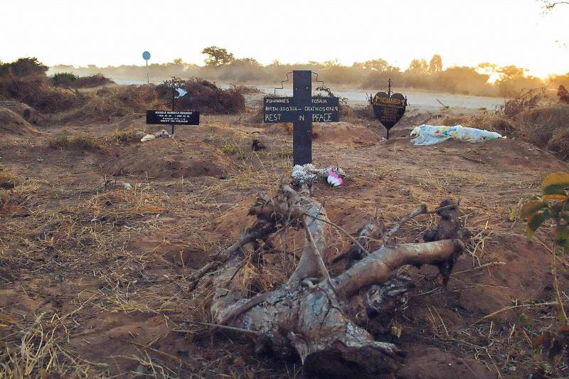 An illegal roadside graveyard in northeastern Namibia. People in the townships surrounding Rundu, a town on the border to Angola, are too poor to afford a funeral plot at the municipal graveyard — and resorted to burying their dead next to a dusty grave