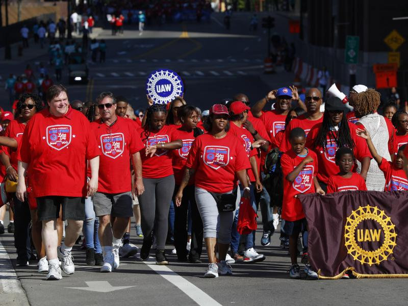 United Auto Workers members walk in the Labor Day parade' in Detroit, Monday, Sept. 2, 2019.