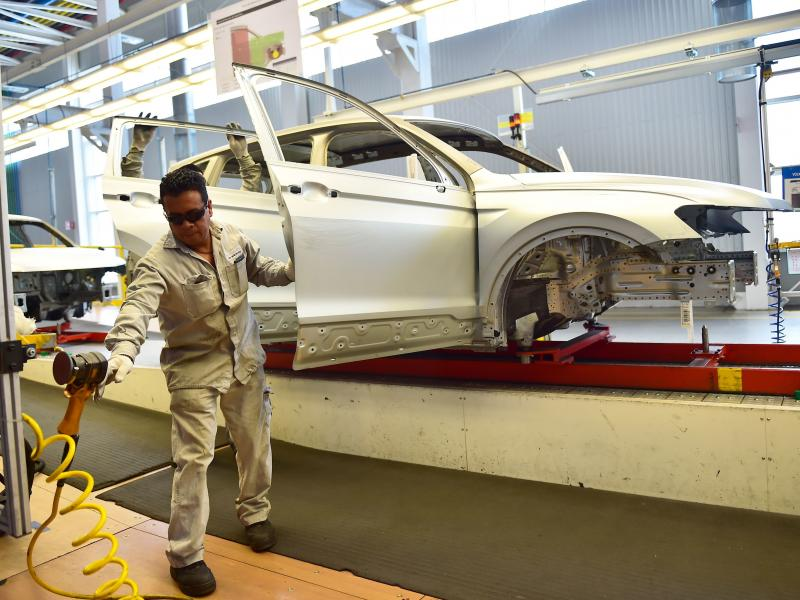 Employees work on the assembly line of the Tiguan model at the Volkswagen car plant in Puebla, central Mexico, in March. The auto sector is a key focus of the newly revised North American Free Trade Agreement.
