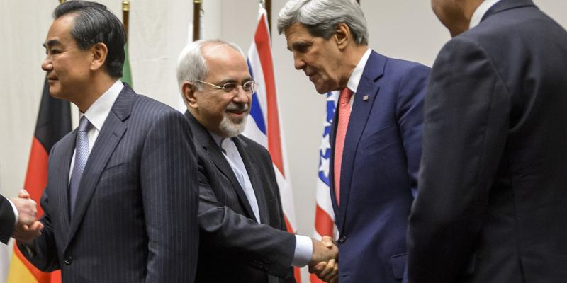 Iranian Foreign Minister Mohammad Javad Zarif shakes hands with U.S. Secretary of State John Kerry on Nov. 24 in Geneva, after the announcement of a deal halting parts of Iran's nuclear program.