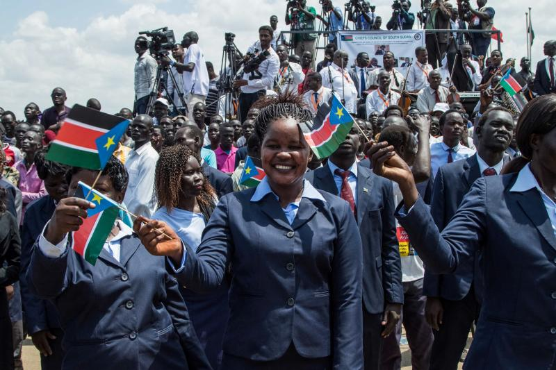 People waved the national flags of South Sudan during a peace ceremony in the capital city of Juba last Thursday. South Sudan rebel leader Riek Machar returned to Juba after two years of exile, saying he had come bearing a message of peace.