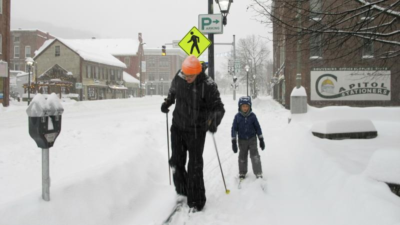Nicholas Nicolet and his son Rocco cross-country ski on Sunday in Montpelier, Vt. A major winter storm hit the Midwest and New England this weekend.
