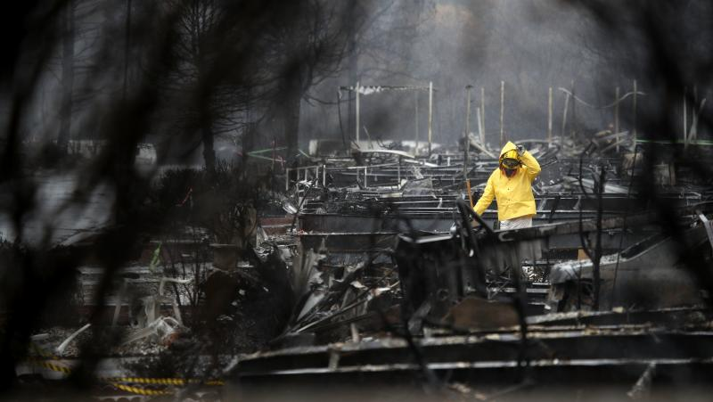 California wildfire death toll rises to 76 as Trump sees devastation