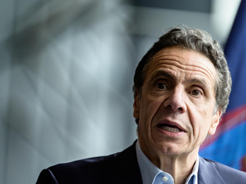 """""""While none of this is good news, the ... possible flattening of the curve is better than the increases that we have seen,"""" New York Gov. Andrew Cuomo said Monday. He is seen last month following the arrival of the U.S. Naval hospital ship Comfort to New"""