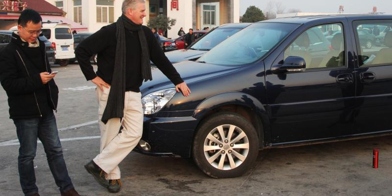 NPR's Frank Langfitt has been offering free taxi rides around Shanghai to talk to ordinary Chinese. He drives a Camry around the city, but rented a van for a trip 500 miles outside the city earlier this year. He recently decided to buy a car, which can be