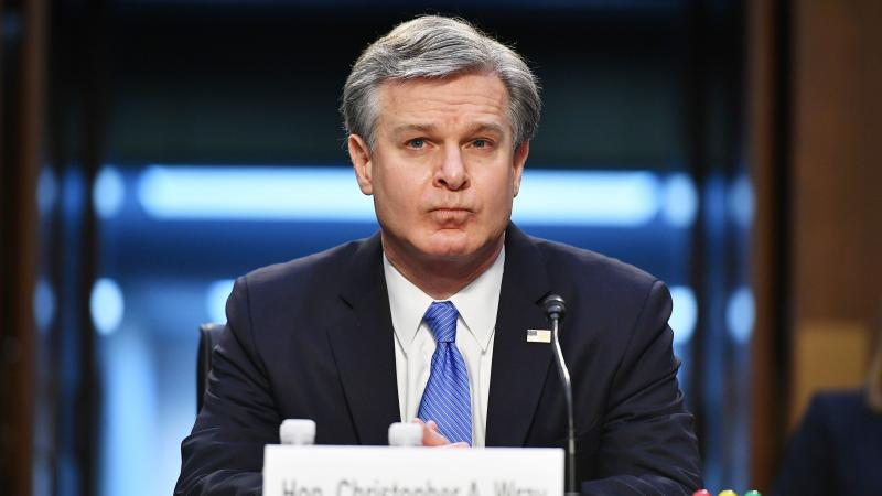 FBI Director Christopher Wray arrives Tuesday to testify before the Senate Judiciary Committee regarding the Jan. 6 insurrection at the Capitol.